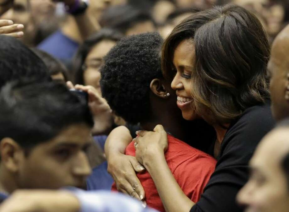 First lady Michelle Obama hugs a high school student during College Signing Day, an annual celebration of San Antonio high school seniors committing themselves to higher education Friday.