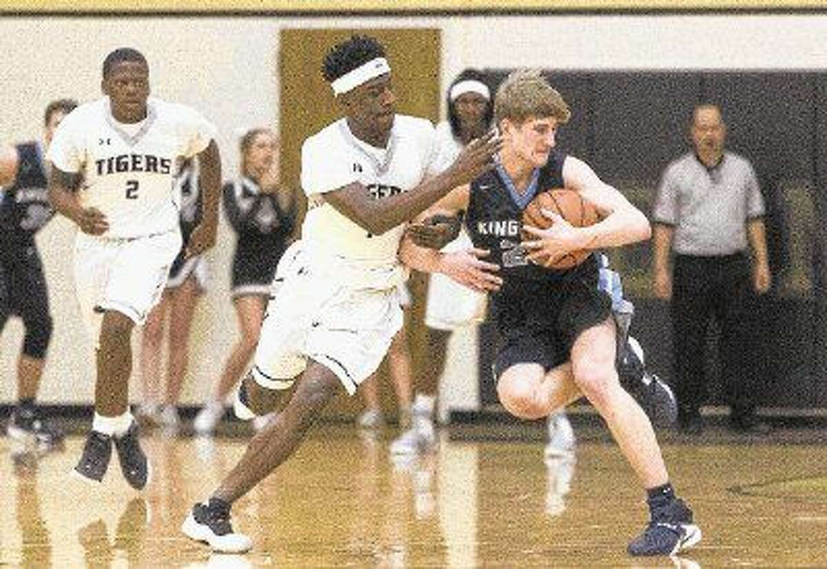 Conroe guard Jay Lewis fouls Kingwood guard Chase Lovins earlier this month. The Mustangs defeated the Tigers at The Pit.