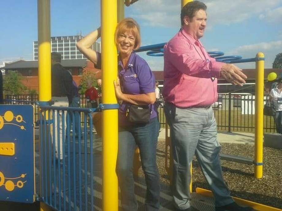Rotarian Christine Rathbun, always young at heart, enjoys the Beaumont Rotary Centennial Playground while on tour there as part of the rotary district 5910 conference last weekend.