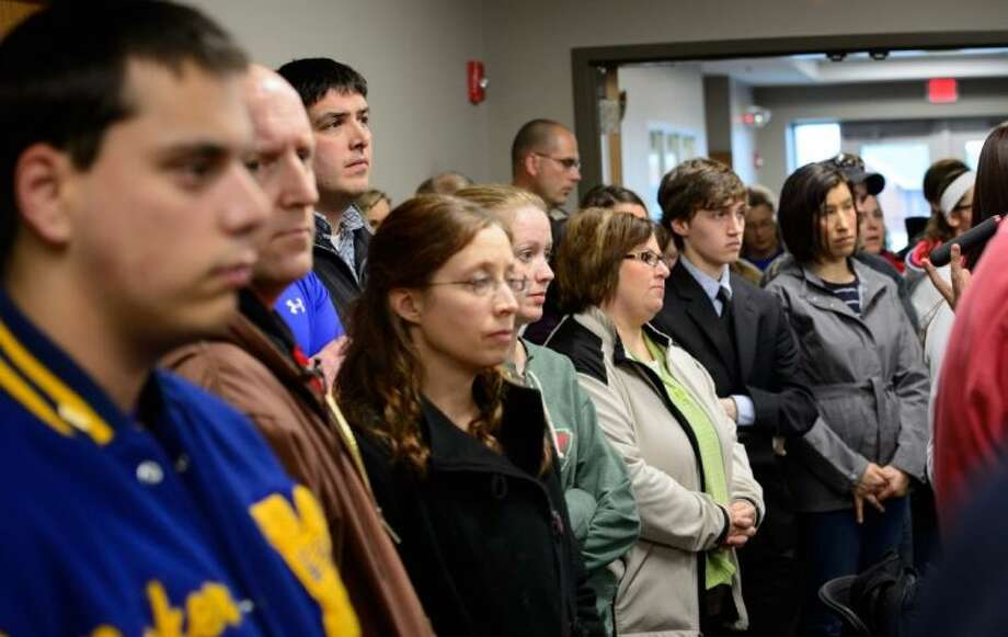 Students, parents and community members stand in the back of the room to listen as Waseca Police Captain Kris Markeson and Waseca school Superintendent Tom Lee speak at a news conference about the 17-year-old arrested in plot to kill family and massacre students at a Waseca school.