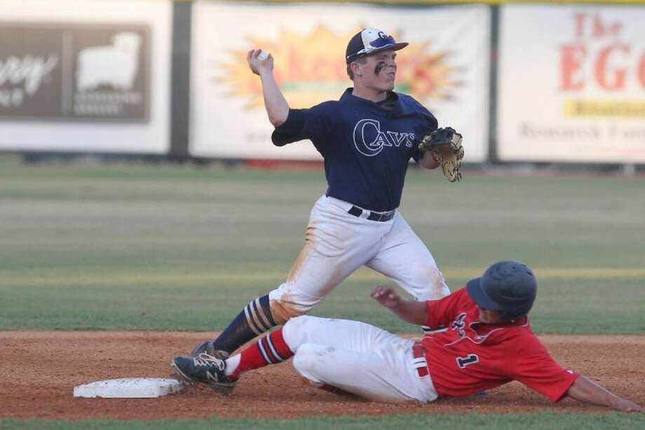 College Park's Justen Heinrich turns a double-play against Atascocita. The Eagles defeated College Park 9-4 to sweep the two-game bi-district series. To view or purchase this photo and others like it, visit HCNpics.com. Photo: Jason Fochtman