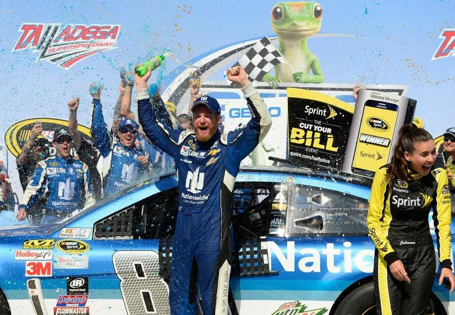 Dale Earnhardt Jr. celebrates in Victory Lane after winning the Talladega 500 NASCAR Sprint Cup Series auto race. Photo: David Tulis