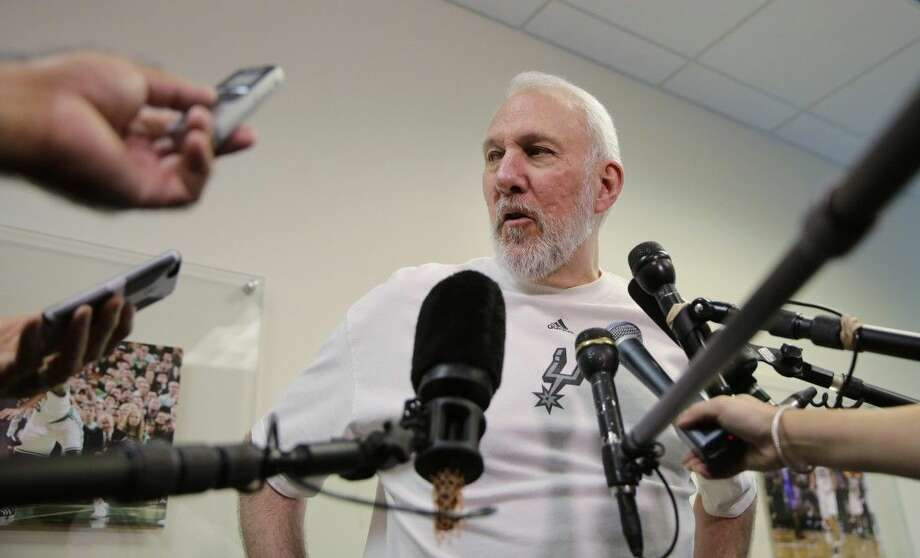 Spurs coach Gregg Popovich speaks with the media. Photo: Eric Gay
