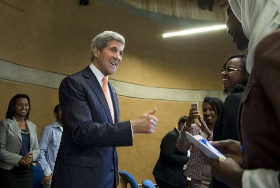 U.S. Secretary of State John Kerry, center, greets students with the Young African Leaders Initiative prior to speaking about U.S. policy in Africa at the Gullele Botanic Garden in Addis Ababa, Ethiopia Saturday, May 3, 2014. America's top diplomat said the U.S. is ready to help increase its ties with Africa, but nations across the continent need to take stronger steps to ensure security and democracy for its people. Photo: Saul Loeb