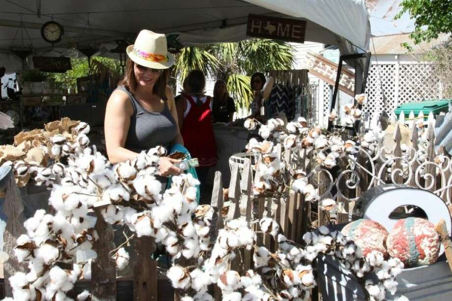 Lorri Merecka, of Cypress, shops at one of the booths during the 15th Annual Antiques Festival in downtown Montgomery Saturday.