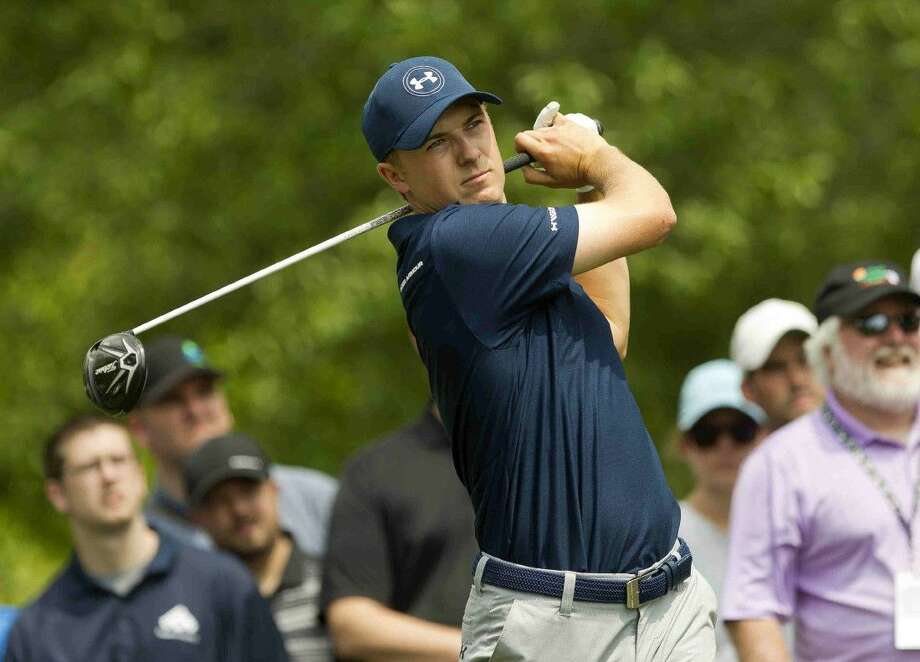 Jordan Spieth hits his tee shot on the second hole during the first round of the Houston Open golf tournament March 31, 2016, in Humble, Texas. caddie Michael Greller Photo: Jason Fochtman