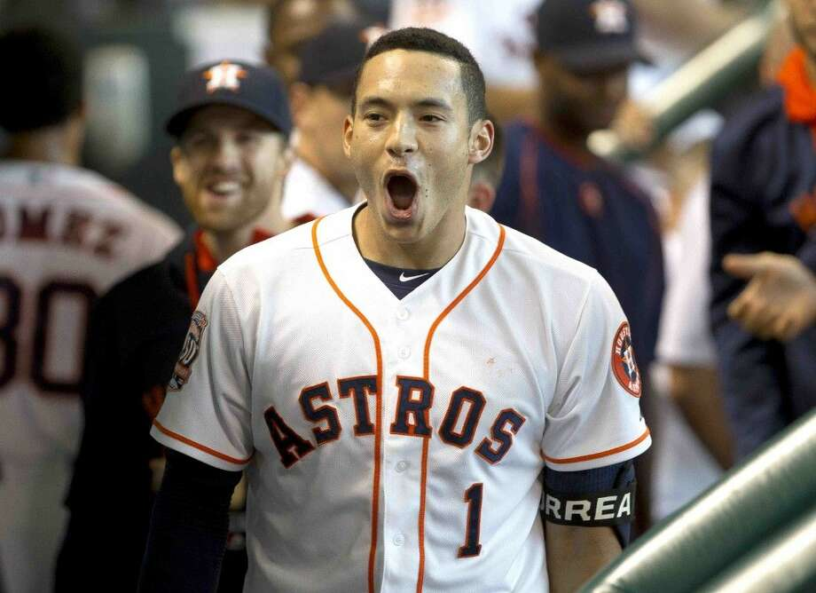 Houston Astros shortstop Carlos Correa celebrates in the dugout after hitting a solo home run in the first inning of an MLB baseball game last season. Photo: Jason Fochtman