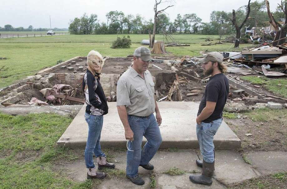 Neighbors of Craig Foraker check out his property after a tornado devastated the area near Bentley, Kan., on Wednesday. Photo: Travis Heying