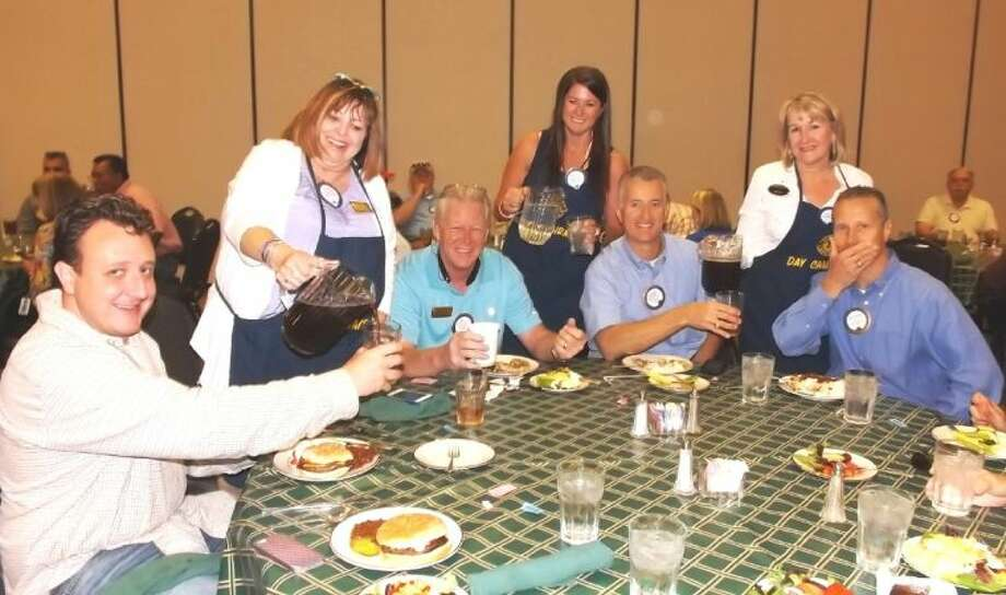 with a Smile - Lady Lions of the Conroe Noon Lions Club paid off their bet as the losing team in the 'Battle of the Sexes' membership by serving lunch to the guy Lions in the group. pictured: standing (r-l) Susie Yeager, Kelley Ringo, Gail Cain, seated (r-l) Isaac Franke, Wayne Colby, Rich Sproba, Mike Sproba.