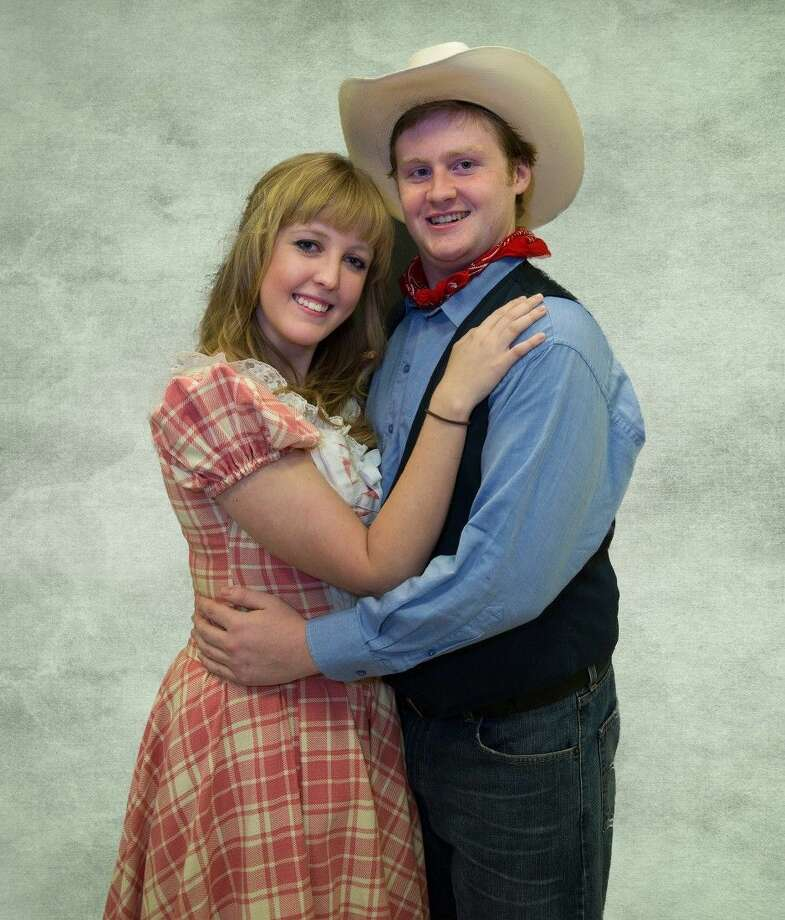 """Joshua Yost as Curly and Jordan Kearny as Laurie in the Players' currently production of """"Oklahoma!"""" which is on the Owen Theatre stage this weekend."""