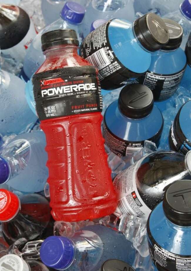 In this Aug. 5, 2010 file photo, bottles of Powerade sports drink and other Coca-Cola products are chilled over ice in Orlando, Fla. A controversial ingredient, brominated vegetable oil, is being removed from some Powerade sports drinks. Photo: Jon Elswick