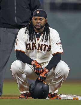 San Francisco Giants' Johnny Cueto squats on second base after two runs scored on a Colorado Rockies' error after his 8th inning sacrifice bunt during MLB game at AT&T Park in San Francisco, Calif., on Thursday, September 29, 2016.