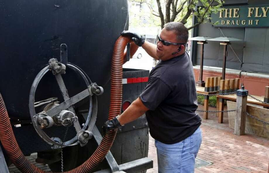 Clay Carrillo-Miranda pumps used grease into a tanker Thursday April 23, 2014 in Fort Worth, Texas. Carrillo-Miranda drives a tanker truck that picks up used kitchen grease from area restaurants. Because of bio-diesel demand and prices, there's an upsurge of grease thefts. Photo: Ron Jenkins