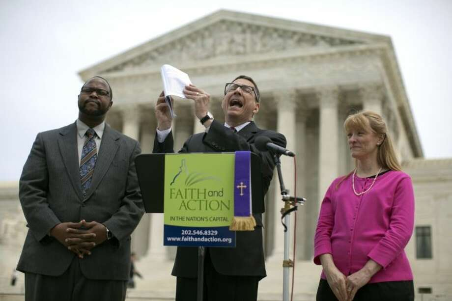 Reverend Dr. Rob Schenck, of Faith and Action, center, speaks in front of the Supreme Court with Raymond Moore, left, and Patty Bills, both also of Faith and Action, during a news conference, Monday, May 5, 2014, in Washington, in favor of the ruling by the court's conservative majority that was a victory for the town of Greece, N.Y., outside of Rochester. A narrowly divided Supreme Court upheld decidedly Christian prayers at the start of local council meetings on Monday, declaring them in line with long national traditions though the country has grown more religiously diverse. Photo: Carolyn Kaster