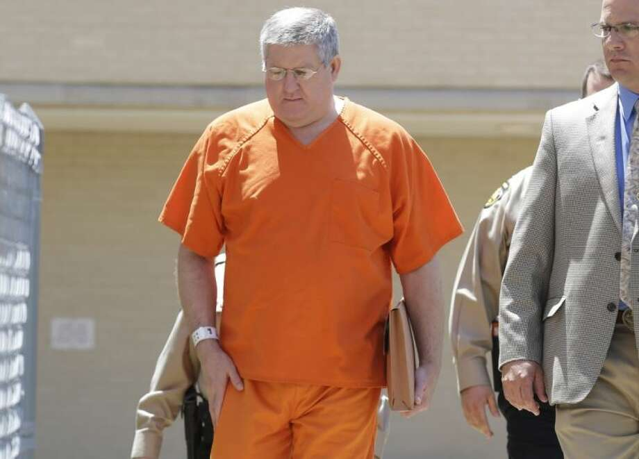 "Bernie Tiede is led into the Panola County court house by law enforcement officials in Carthage, Texas, Tuesday, May 6, 2014. The former mortician serving a life sentence for the death of a rich East Texas woman could soon go free with the agreement of the district attorney who prosecuted him. Tiede, whose case inspired the Matthew McConaughey movie ""Bernie,"" is expected in court in Carthage, Texas."