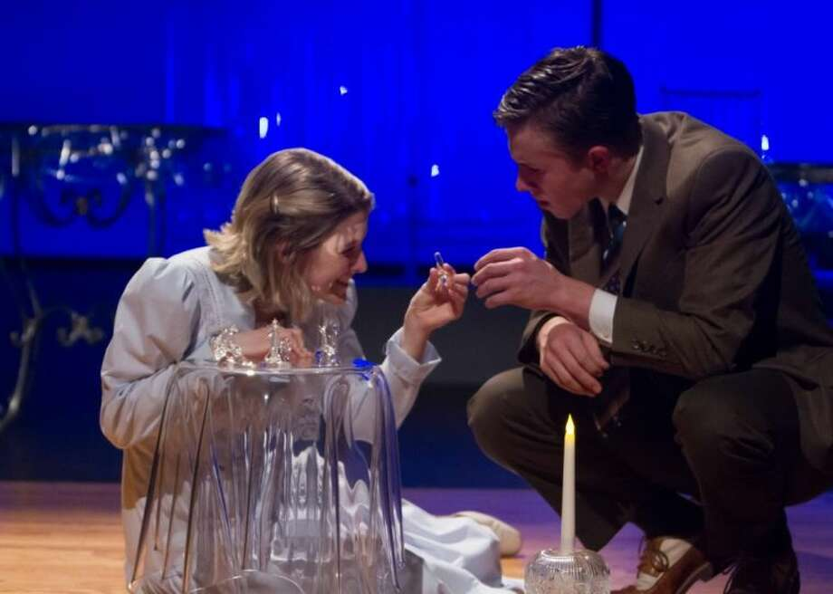 Montgomery High School theater students Bailey Oliver and Jack Russell play the roles of Laura Wingfield and the Gentleman Caller during a scene in The Glass Menagerie. Photo: Wes Ward