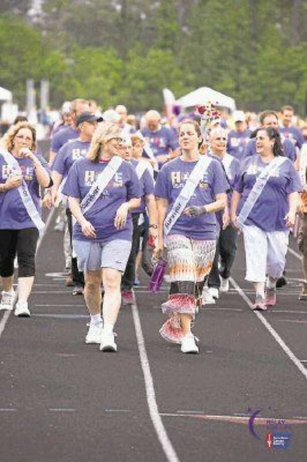 Women visit with each other as they lap the track for Relay for Life. The event will be hosted from 6 p.m. to midnight April 15 at The Woodlands College Park High School.