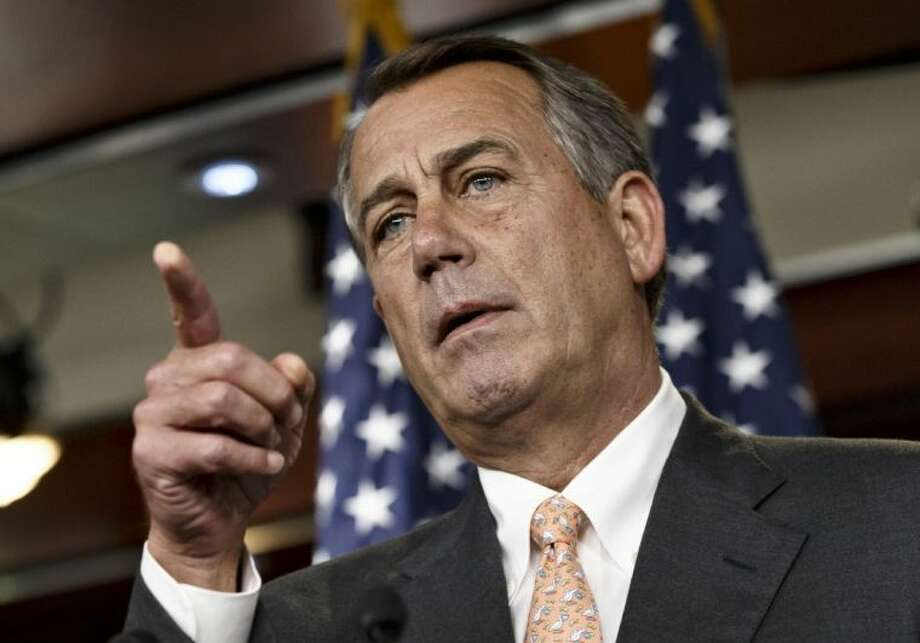 Speaker of the House John Boehner is asked about the special select committee he has formed to investigate the deadly 2012 attack on the U.S. diplomatic post in Benghazi, Libya, raising the stakes in a political battle with the Obama administration as the midterm election season heats up, during a news conference on Capitol Hill in Washington Thursday.