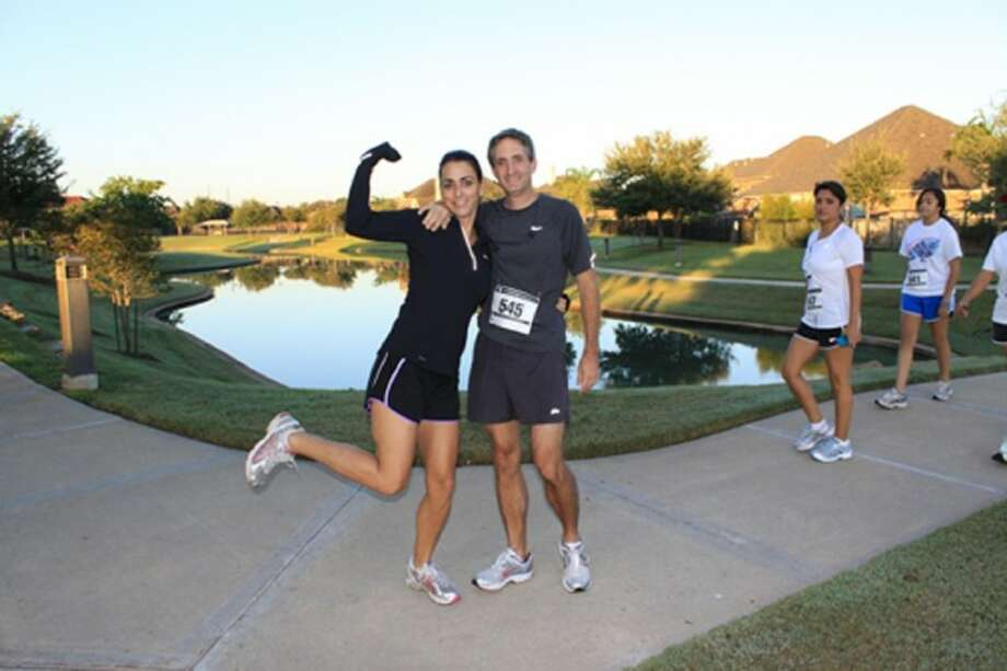 Lisa and Bart Walker celebrate their finish at last year's Heart and Sole 5K in Riverstone. This year's event, set for Sept. 29, again benefits Fort Bend Seniors Meals on Wheels. Registration is now open. Photo: Submitted Photo