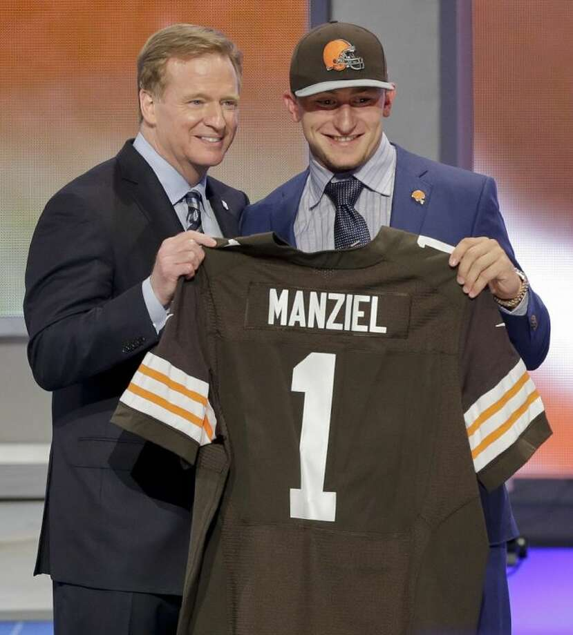 Texas A&M quarterback Johnny Manziel poses with NFL commissioner Roger Goodell after being selected by the Cleveland Browns as the 22nd pick in the first round of the NFL Draft. Photo: Frank Franklin II