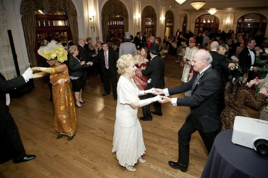 Rice Hotel's Crystal Room, recently restored to its original decor from 1911, was the backdrop for the Rotary Club of Houston's 100th birthday party. The hotel was the meeting place for the club for 73 years. Dancers Gloria Sanderson, Fabiola and Nick Giannone dressed to commemorate the era during the celebration.