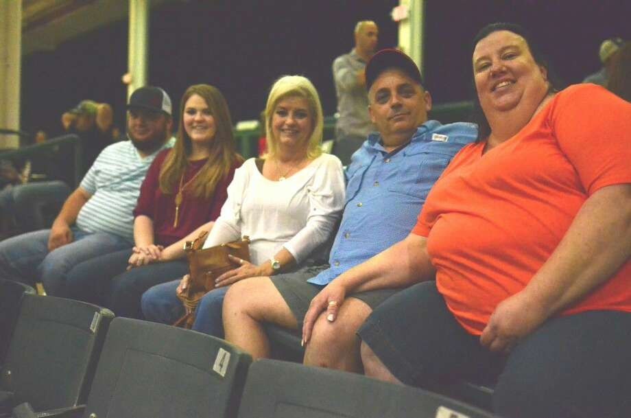 Two families, pictured here Friday, have been attending the Montgomery County Fair for decades, some for almost 50 years.