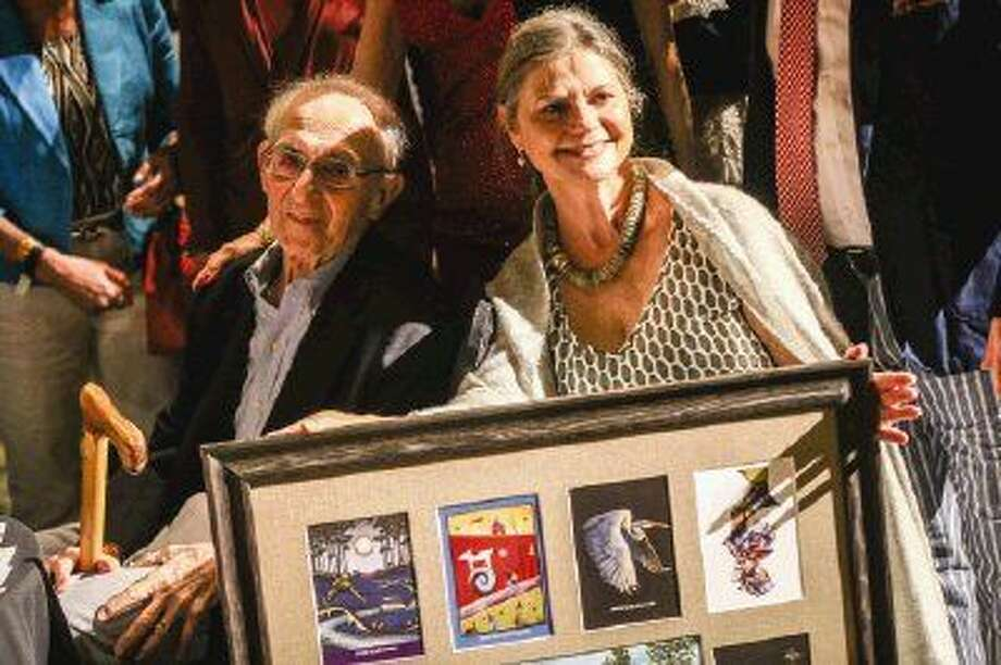 David and Brenda Gottlieb are recognized with an award during the Art Dash Party on Friday at The Woodlands Waterway Marriott Hotel & Convention Center. Photo: Michael Minasi