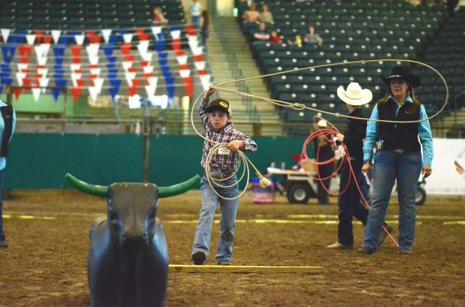 Cooper Anderson, 7, ropes his final dummy cattle to seal his champion status Friday at the Montgomery County Fair Youth Rodeo.