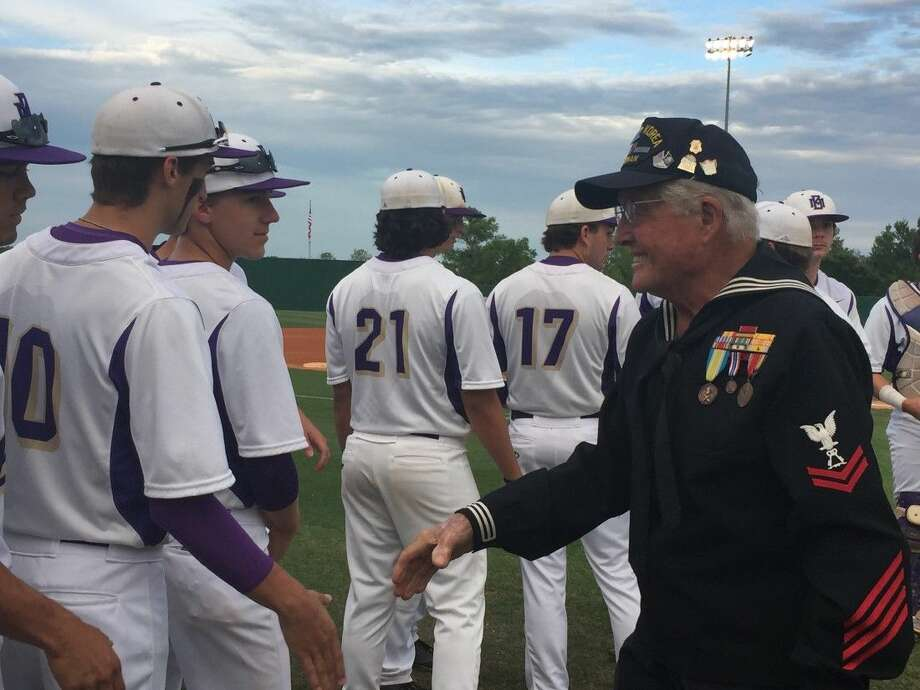 "Navy veteran Herman Isaac ""Ike"" Hargraves greets Montgomery Bears baseball players during a pregame ceremony that honored veterans Friday night in Montgomery."