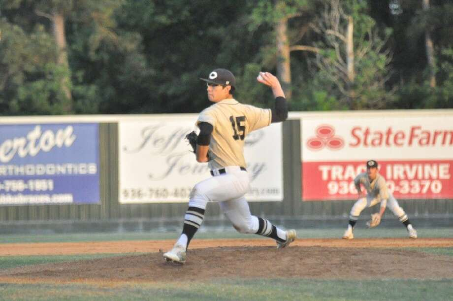 Conroe pitcher Brandon Birdsell fires a pitch against The Woodlands on Friday.