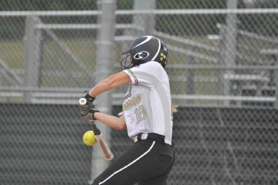 Conroe's Holly Stalinsky hits the ball the other way against Summer Creek on Friday. Photo: Keith MacPherson