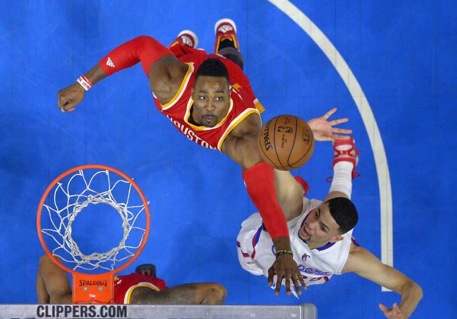 Rockets center Dwight Howard, left, and Clippers guard Austin Rivers battle for a rebound. Photo: Jae C. Hong