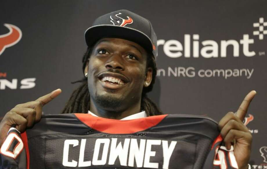 Jadeveon Clowney, the Houston Texans' No. 1 overall draft pick, holds up his new jersey at a news conference. Photo: Pat Sullivan