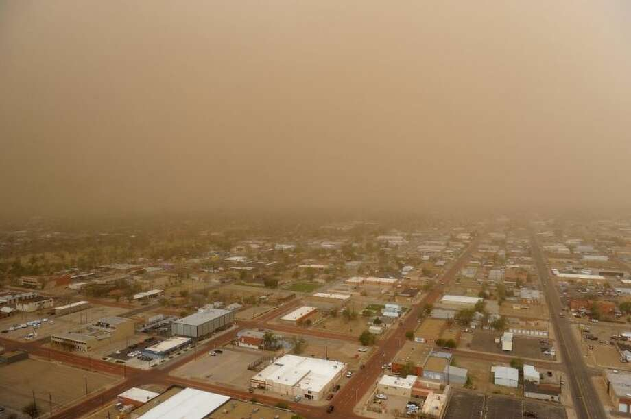 In this April 29 file photo, high winds create a dust storm across the Texas panhandle blanketing Amarillo in a cloud of red dirt. Due to the drought conditions that have been a constant presence since 2011, some parts of the Texas and Oklahoma panhandles, northeastern New Mexico and southeastern Colorado are drier now than they were during the infamous dry spell of the 1930s.