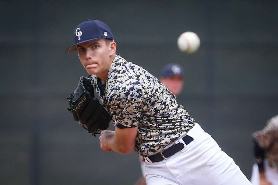 College Park's Nick Pischulla (19) throws a pitch during the high school baseball game against Waltrip on Saturday at College Park High School. Photo: Michael Minasi