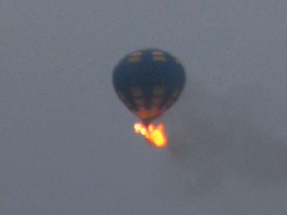 This photo provided by Nancy Johnson shows what authorities say is a hot-air balloon that was believed to have caught fire and crashed in Virginia, Friday.