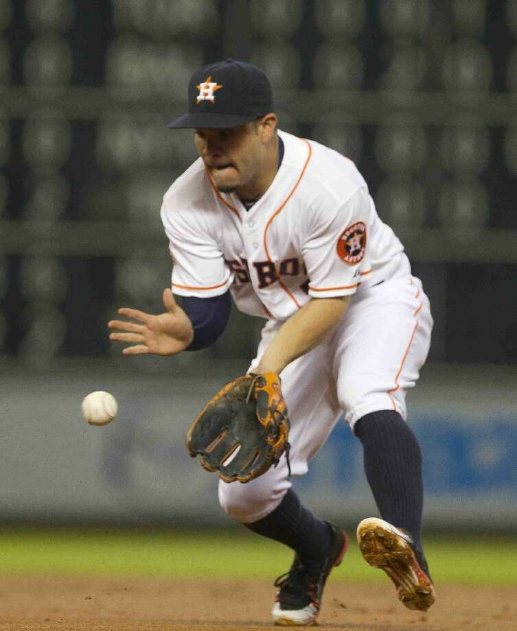 Houston Astros second baseman Jose Altuve fields a ground ball on Tuesday in Houston. Photo: Jason Fochtman
