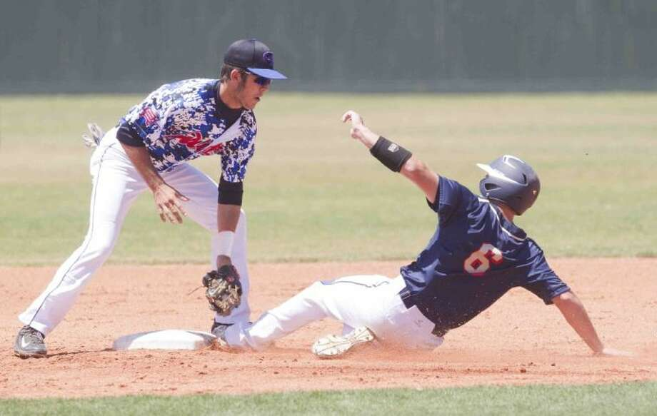 Oak Ridge's Grant Ware gets Klein Collins' James Kuykendall out at second base during Game 3 of a bi-district playoff baseball game at Oak Ridge High School Saturday. Klein Collins defeated Oak Ridge 7-3. To view or purchase this photo and others like it, visit HCNpics.com. Photo: Jason Fochtman