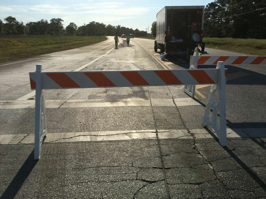 Police closed the western portion of Lone Star Parkway between Texas 105 and Liberty Street after a chemical spill Tuesday afternoon. Photo: Staff Photo By Jay R. Jordan