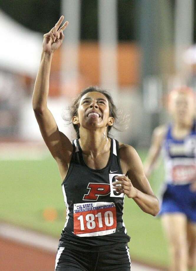 Porter's Evelyn Chavez celebrates after finishing second in the Class 4A girls 1,600-meter run during the UIL State Track and Field Championships at Mike A. Myers Stadium in Austin Friday. To view or purchase this photo and others like it, visit HCNpics.com. Photo: Jason Fochtman