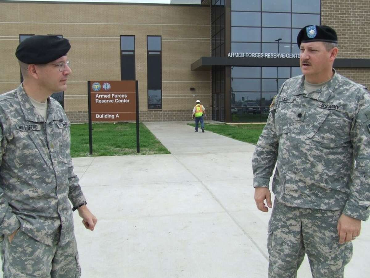 Maj. Mark Williford, public affairs officer for the 75th Battle Command Training Division of the Army Reserves, and Lt. Col. Jon Elliott, deputy division engineer of the 75th Battle Command, in front of the new Armed Forces Reserve Center at Ellington.