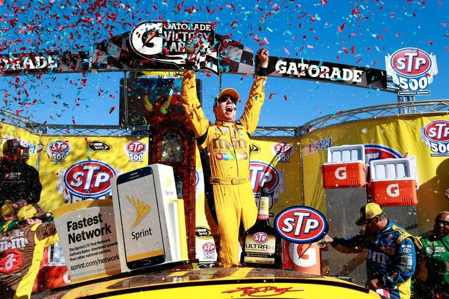 Kyle Busch, driver of the #18 M&M's 75th Anniversary Toyota, celebrates in Victory Lane after winning the NASCAR Sprint Cup Series STP 500 at Martinsville Speedway on April 3, 2016 in Martinsville, Virginia. Photo: Matt Sullivan