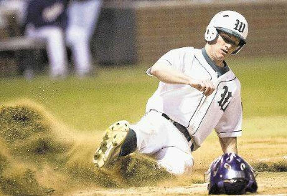 The Woodlands' Ben Gooch slides into home for a run during a game at The Woodlands. The Highlanders will play Austin Bowie starting Thursday at The John Cooper School. Photo: Jason Fochtman