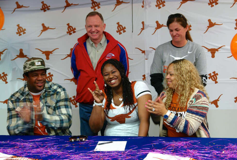 Oak Ridge thrower N'Dia Warren-Jacques signed with the University of Texas at Austin at a special ceremony on Friday. Photo: Staff Photo By Jon Poorman