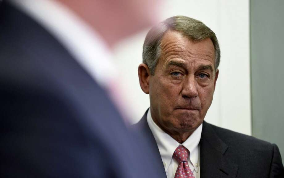 House Speaker John Boehner of Ohio listens during a news conference on Capitol Hill in Washington, Wednesday. Photo: Susan Walsh