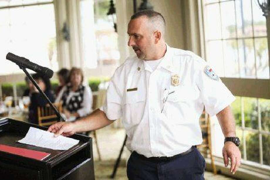 Brian Edwards, Montgomery Fire Chief, speaks at the North Shore Republican Women meeting about the district's sales tax proposal on Wednesday at Bentwater Yacht Club. Photo: Michael Minasi