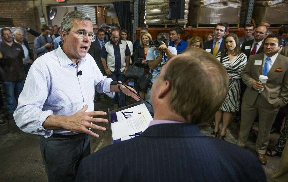 Former Florida Gov. Jeb Bush answers a question from small business owner Nick Goodman at a town hall meeting at Four Peaks Brewery Thursday in Tempe, Ariz. Photo: Tom Tingle