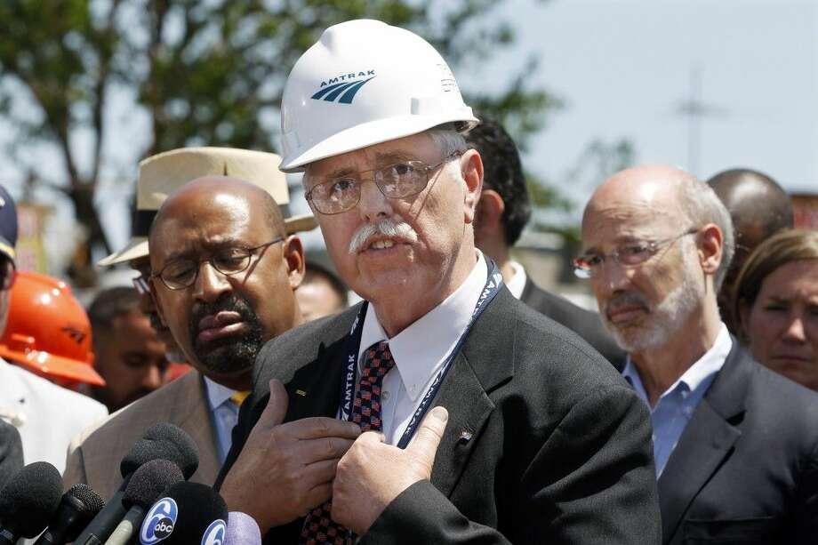 As Philadelphia Mayor Michael Nutter, left, and Pennsylvania Gov. Tom Wolf, right, listen Amtrak CEO, Joseph Boardman expresses his sorrow near the site of a deadly train derailment Thursday in Philadelphia. Photo: Mel Evans