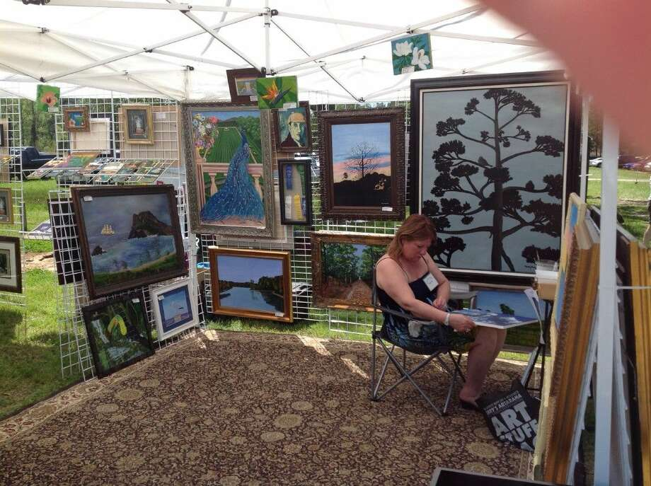 Humble resident Mary Roseberg presents some of her artwork at the annual Texas and Wine Art Festival held in Old Town Spring.