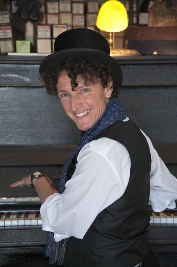 A worldbeat-vaudeville extravaganza, ZOË LEWIS is a band in a body. She performs on Saturday at Millbend Coffeehouse.